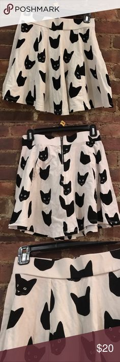 H&M patterned cat skirt, size small H&M black and white patterned cat skirt, size small. Check out this a ADORABLE skater skirt and add a little character to your closet! This piece is extremely versatile--wear it in the winter with tights and a blouse or in the summer with a simple tank. Skirt is in great condition! H&M Skirts Circle & Skater