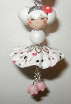 PENDENTIF POUPEE  FIMO JUPE YOYO BLANC A POIS                                                                                                                                                                                 Plus Doll Crafts, Bead Crafts, Jewelry Crafts, Clothespin Dolls, Tiny Dolls, Kokeshi Dolls, Handmade Beads, Miniature Dolls, Wooden Beads