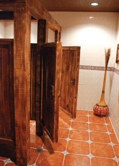 Bathroom stalls with wood doors floor tile same style we for Commercial bathroom partition doors