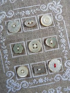 vintage buttons on a pillow