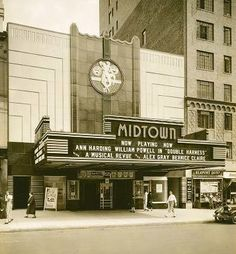 The Midtown Theater was completed in 1933 and designed by Russell M. Boak and Hyman Paris in the Art Deco style.