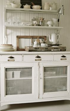 The screen cabinet fronts resemble an antique pie safe, in this cottage kitchen. #cottage #home decor #screen cabinet fronts