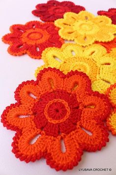 Rainy day crochet: crochet flower coasters: read more at LoveCrochet!