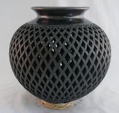 beautiful carved black clay vase