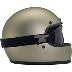 Biltwell Gringo DOT Helmet - Flat Titanium  • Injection-molded ABS outer shell with hand-painted finish • Expanded polystyrene inner shell • Hand-sewn brushed Lycra liner w/ contrasting diamond-stitched quilted open-cell foam padding • Meets DOT safety standards • Internal BioFoam chin pad with hand-sewn contrast stitching • Rugged plated steel D-ring neck strap with adjustment strap end retainer • Rubber edging on shell and eye port  $159.95