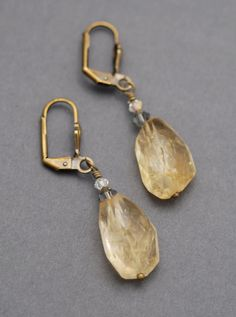 PROTECTIVE ABUNDANCE: Chunky Citrine gemstone earrings (Citrine faceted stones, Brass shell lever backs, and gray/clear Swarovski crystals)