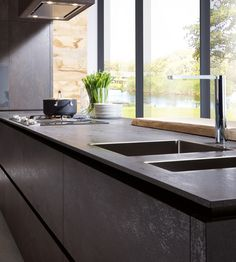 contemporary kitchen - dark - no upper cabinets - window wall -