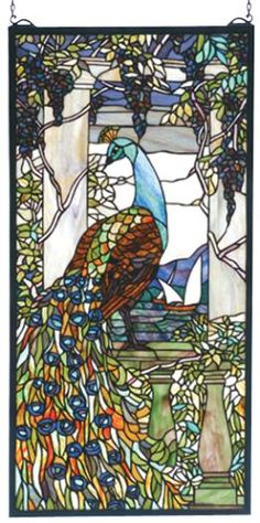 Reproduction of Louis Comfort Tiffany Peacock originally created in the early 1800'S.   Meyda Tiffany has used 1535 Pieces of stained glass & painstakingly reproduced Tifanny's original as close as possible to the original colors.