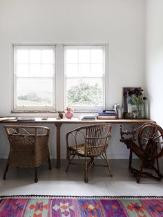 vintage workspace with beautiful rug and rattan chairs and natural light - Tamsin Carvan and Family — The Design Files
