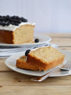 Lemon cake topped with coconut and blueberries / / Lemon pound cake with coconut frosting and blueberries