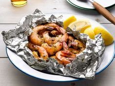 Delish! Foil Packet Garlic Shrimp: Combine 1/2 stick softened butter, 1 C chopped parsley, 2 chopped garlic cloves, and salt and pepper. Toss with the juice of 1 lemon, 1 pound unpeeled large shrimp and a big pinch of red pepper flakes. Divide between 2 foil packets. Grill over high heat for 8 minutes.  Double or triple as needed.