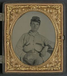 """A young Confederate soldier wearing a battle shirt with a """"Georgia Frame"""" belt buckle."""