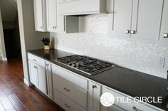Kitchen Design With White Cabinet And Mother Of Pearl Tile Also Maya Romanoff Mother Of Pearl With Cooktop And Granite Countertops Plus Kitchen Utensils Storage With Mother Of Pearl Backsplash Tile