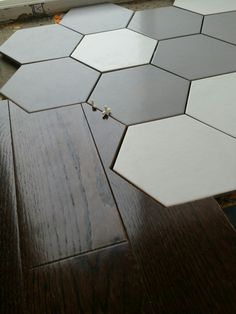 My kitchen floor install, I used a hexagonal tile and made my hardwood blend into it.