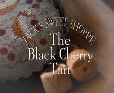 The Black Cherry Tart is the title of this cross stitch pattern from Plum Street Samplers that is stitched with Gentle Art Sampler threads
