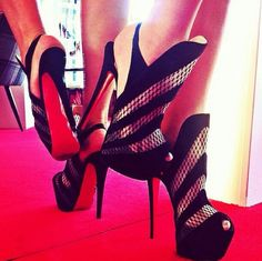 ONE Nice Pair of black Heels... long heels red bottoms