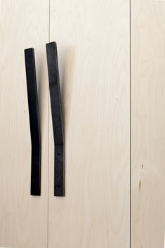 Black pull handles. Plywood House by Simon Astridge. #minimal