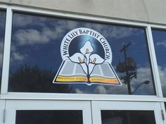 Window graphics for the entrance of White Lily Church. #WindowGraphics #Pittsburgh #Sign