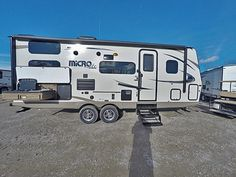 """BUNKHOUSE RV WITH OUTSIDE KITCHEN  2017 Forest River Flagstaff Micro Lite 25BRDS With the ability to sleep up to 8 people, this 25' 9"""" travel trailer weighs in at only 5,074 lbs. (dry) for easy towing through the mountains. Inside you'll find a space-saving Murphy-style bed, bunk beds, a large U-shaped dinette, full kitchen and bath, and a swing-out camp kitchen outside.  Give our Flagstaff Micro Lite expert Aaron Roberts a call 517-204-2624 for pricing and more information."""