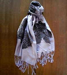 Unleash your inner siren with this hand-printed Seafan Scarf. The white viscose and silk scarf is printed with an original seafan pattern.