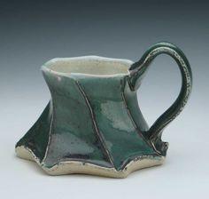 Dancing Mug, Forest Green Glaze ( Etsy:: http://www.etsy.com/listing/88528748/dancing-mug-forest-green-glaze# )