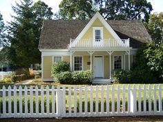 What my dream home looks like... Yellow little house with picket fence. :)