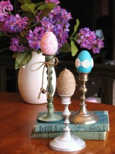 with Easter soon, here is an idea for decorating.  Simple and beautiful.  Large vase of flowers with your own decorated eggs in candle holders.  Love it.