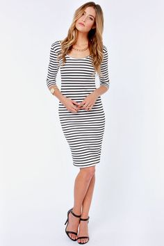 "You better start practicing your poses because whenever you wear the Stripe a Pose Black and White Striped Bodycon Dress, the paparazzi are sure to follow! Black and white stripes skip across stretchy knit that's sure to flatter your figure down an enticing bodycon shape. A scoop neckline front and back adds flirty sex appeal and is balanced out by classy three-quarter sleeves and a midi-length hem. Unlined. Model is 5'8"" and is  wearing a size small. 97% Polyester, 3% Spandex. Hand Wash…"