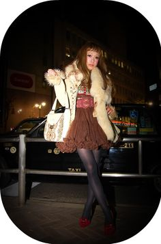 Dolly kei can be short or long. Short looks are worn with solid-color or pattern tights.