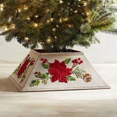 Our tree collar is a unique take on the traditional tree skirt. Embroidered poinsettia and pine motif on a cotton cover is fitted over a metal frame. It's a stunning way to cover your tree stand. Made exclusively for Pier 1, it's stylish yet unique—just like you.