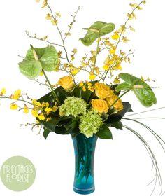 Island Topaz - Peridot tones in Anthirium and green Hydrangea