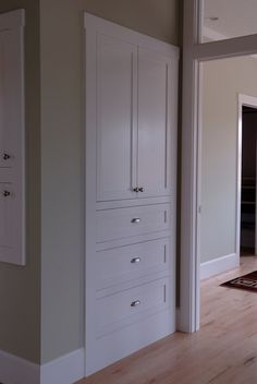 linen closet with cabinet front