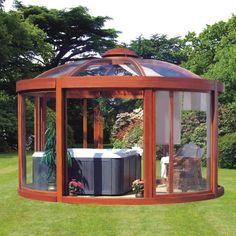 The gazebo can withstand 80-mph wind gusts, has a 28-lb. per square-foot snow load, and the structure is large enough to enclose a hot tub or a table and chairs. 10′ tall  the octagonal gazebo has eight floor-to-ceiling 4 mm-thick polycarbonate panels that provide a 360º view, four of which open and close to let in a breeze or seal out rain and insects. In addition to vents in the transparent roof and a wind-driven fan, the center dome can be lowered and raised for air circulation.