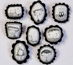 fabric brooches featuring drawings transferred onto fabric, then mounted on black felt.