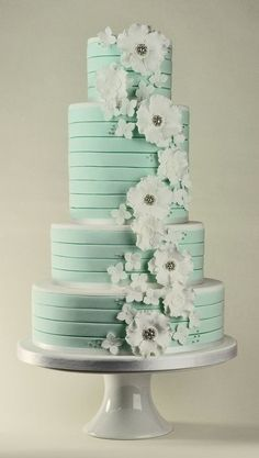 Mint green wedding cake with white flowers.  Love the silver beading in the flower centers - Beautiful!