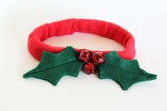 How To Make a Christmas Dog Collar: Stitch the bells to the center of the leaves. From DIYnetwork.com