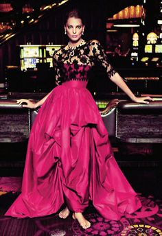 Fuschia pink wedding gown with black lace overlay bodice and sleeves