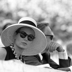 Grace Kelly and her husband Rainier III, Prince of Monaco, at the Olimpic Games in Rome, 1960.