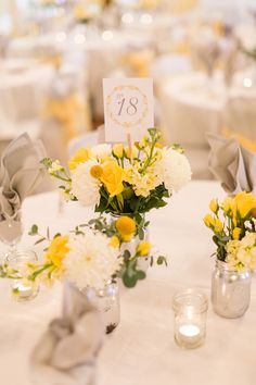 Yellow and White Centerpiece with Mums and Craspedia, , spring wedding flowers, outdoor weddings, wedding table numbers Yellow Flower Arrangements, Yellow Centerpieces, Yellow Bouquets, White Centerpiece, Wedding Centerpieces, Wedding Bouquets, Wedding Dresses, Yellow Wedding Flowers, Floral Wedding