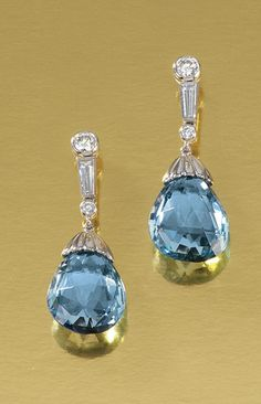 PAIR OF AQUAMARINE AND DIAMOND EAR PENDANTS.  Each surmount set with brilliant-cut and tapered baguette diamonds, supporting a briolette aquamarine drop, post and butterfly fittings, drop detachable.