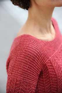 Simple herringbone, vertical twisted ribs, and a slip-stitch yoke provide elegant ingredients for this modern drop-shoulder pullover. Transitions between textures are effortlessly bridged by the structural braid in the back, and a more delicate 'braid' in the front. Add to all of this a yarn with just the right amount of wool, cotton, and silk, and you'll have the perfect comfort sweater!