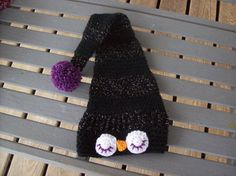 Looking for the perfect photo prop? Looking for the perfect shower gift? Looking for something different? You found it!  This cute little owl hat is hand crocheted in black yarn and a black/silver sparkly yarn. Full purple pom-pom on the end.  Size: Hat is made from a pattern for newborn  to three months depending on size of child.  Hat is approx. 15 inches in circumference.  21 inches long.  Colors may vary due to camera and monitor settings.  Visit us at…