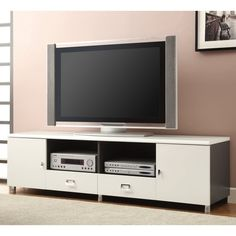 Coaster Furniture White TV Stand. Crafted of solid wood with veneers. Glossy white finish. 2 Open storage compartments. 2 Drawers and 2 Cabinet doors. Maximum TV Size: 70 in.