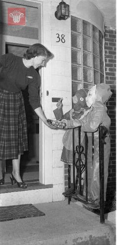 Children trick-or-treat at Halloween, 1950, Worcester Massachusetts. Photograph by George Cocaine.