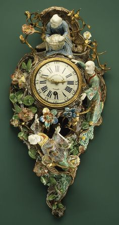 Cartel, or Wall Clock, ca. 1735–40  Movement by Étienne I Le Noir (French, 1675–1739)  Case: soft-paste porcelain with gilt-bronze fittings; Dial: white enamel with blue numerals; Movement: brass and steel