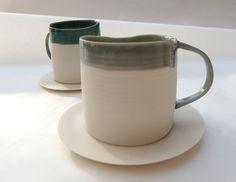 porcelain espresso cups + unglazed saucers