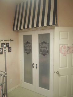Awning over the closet with frosted doors. How cute!