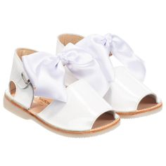 4b8eff61f398 Couponchild. The latest news about kids fashion. Little girls gorgeous  white Early Days sandals made from patent leather.