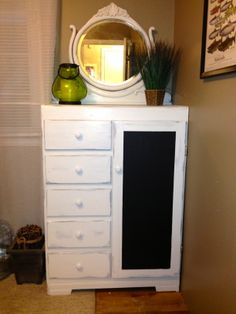Vintage Child's Armoire and antique mirror I added to the guest room. Chalkboard door and distressed paint. The mirror goes perfect with it.