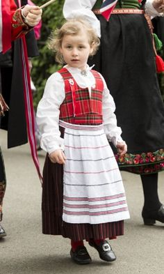Emma Tallulah takes part in a parade in Southwark Park as she celebrates 2013 Norway National Day in London, England